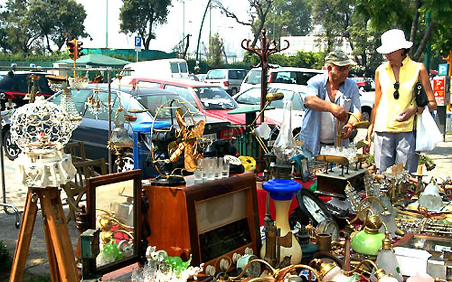 Julie Hendrickson talks to a vendor at an antiques market in Naples, Italy.