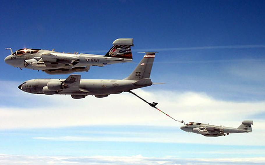 Two EA-6B Prowlers refuel during a training exercise last month over Guam.