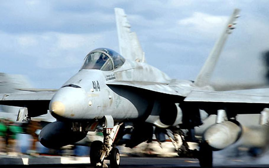 """An F/A-18C """"Hornet"""" with Carrier Air Wing Five's """"Dambusters"""" launches from the USS Kitty Hawk flight deck. The Dambusters recently trained in the Strike Fighter Advanced Readiness Program on Guam."""