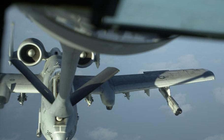 An A-10 Thunderbolt takes on fuel from a KC-135 Stratotanker while flying over the ocean off the west coast of South Korea Thursday.