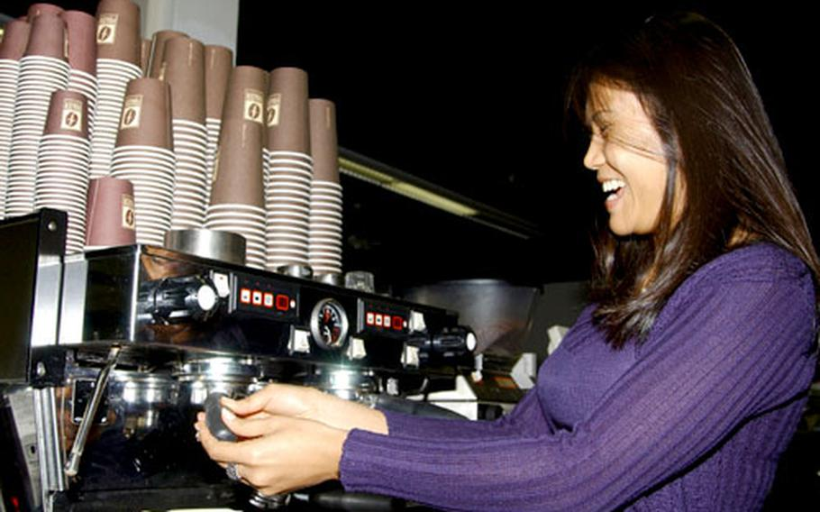 Jintana Ernst serves coffee with a smile at Frazer Coffee's location at the Community Connection at Rhein Main Air Base.