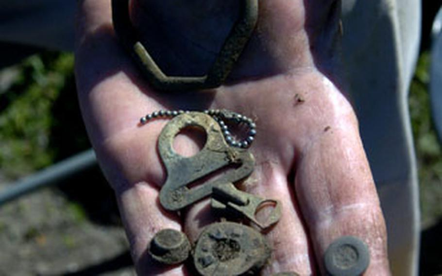 Artifacts found at the site include uniform buttons, dog tag chains and life-support equipment.