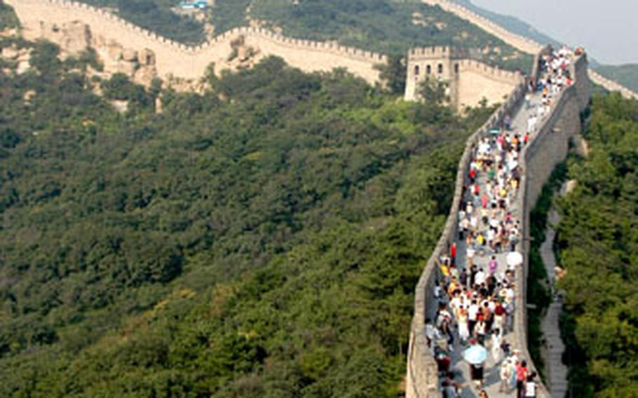 The Great Wall at Balading, where thousands of tourists come each day. To get up to the wall, most people ride a slow-moving roller coaster to avoid the hike. Once on the wall, people can walk to the highest guard post more than a kilometer away.