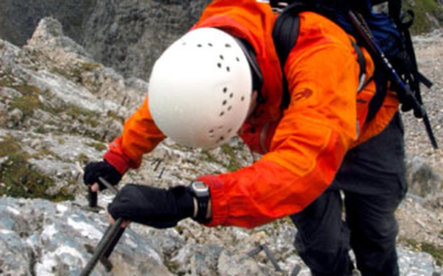 Helmut Grüninger, a weekend warrior from Munich, uses steel cables to climb up the peak of the Alpspitze Mountain.