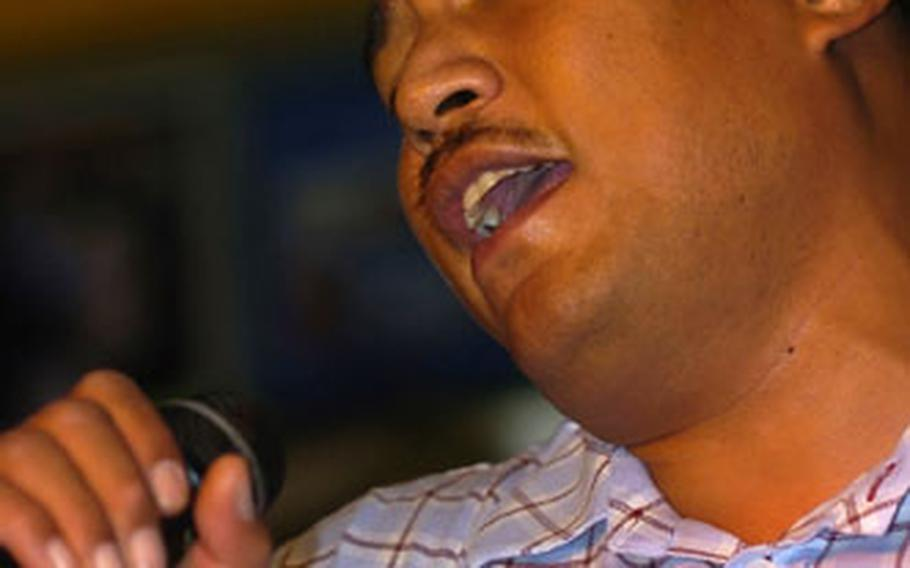 """Sgt. Liatama Mauga, of V Corps in Heidelberg, sang Eric Clapton's """"Tears in Heaven"""" in memory of his father."""