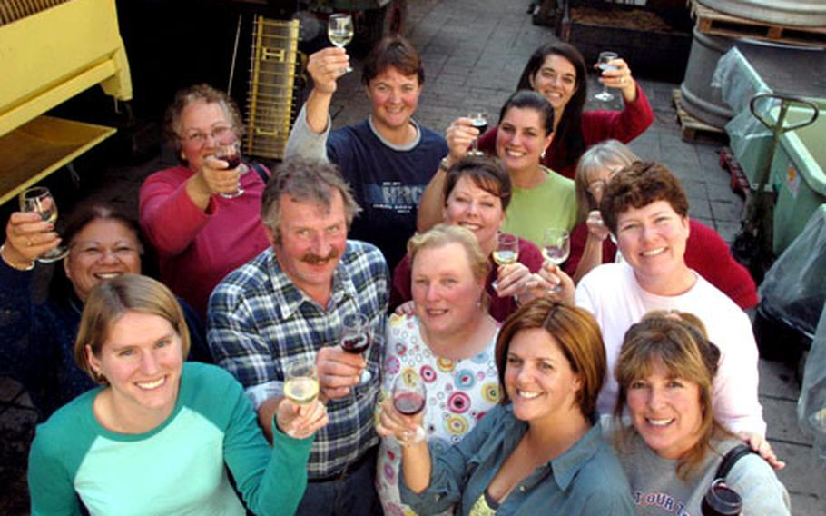 Vintner Helmut Rappenecker and his wife, Erika, center, toast with their visitors of the Wiesbaden Community Spouses Club after a succesful day of grape picking. From left, back row: Lu Yanick, Kathy Bertsch, Alicia Faddis, Colleen Beazer and Stacey Hatfield. In the middle: Debbie Gracia, Sue McGarvey from Manchester, England (hidden) and Marde Mott. Foreground, from left: Molly Heatherly, Marie Muschek and Natasha Foster.