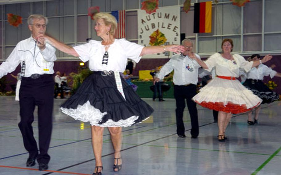 Couples dance the night away at the Beaux and Belles Square Dance Club's Autumn Jubilee in Frankfurt, Germany, in September. European nationals have kept the traditionally American activity alive in areas where, in days gone by, American soldiers and Europeans used to dance and mingle.