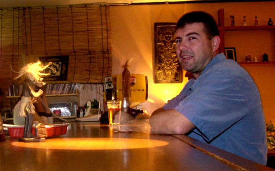 Ron Strickell enjoys a beer at The Peach, a few miles down the road from Awase Meadows Golf Course. The Peach has been serving up food and drinks on Okinawa since 1997.