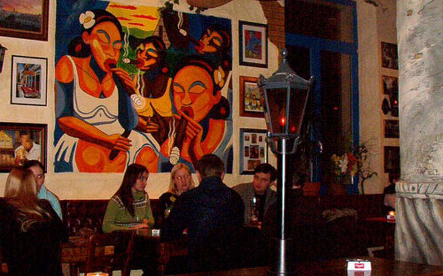 Patrons enjoy a quiet dinner at the Cubana Cocktailbar and Restaurant in Darmstadt, Germany. After 9 p.m., the music turns a more festive.