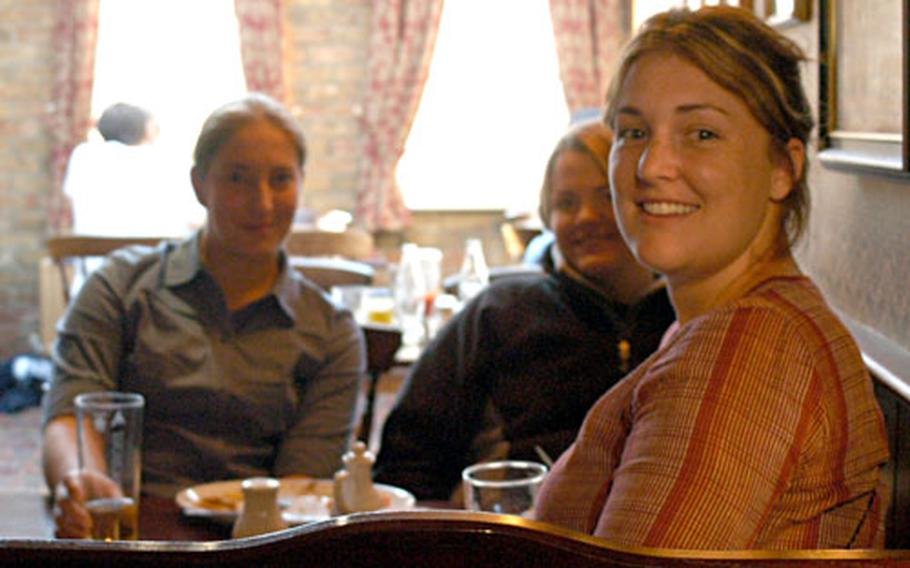 American exchange students, left to right, Jessica, Susannah and Ashley, share a pint and some gossip at the Minster Tavern in Ely, England.