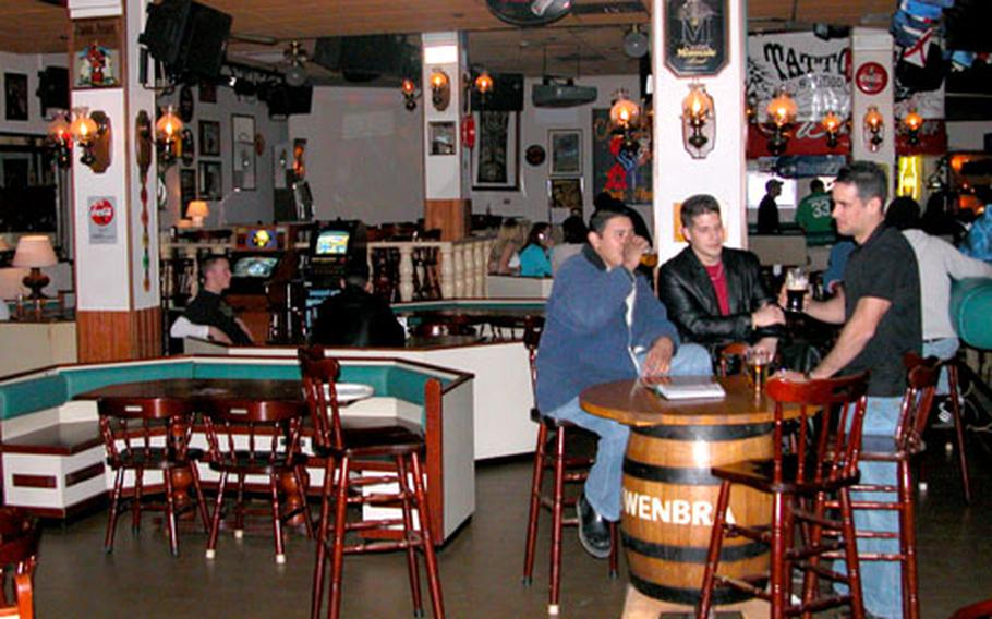 Patrons relax and converse at California Beer Parlor in Aviano, Italy.