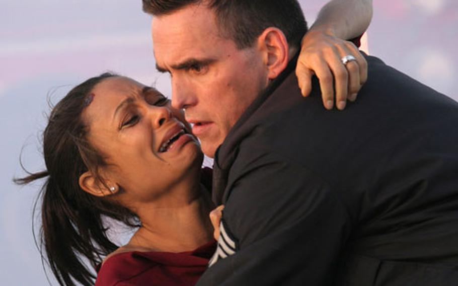 """Actors Thandie Newton, left, and Matt Dillon in a scene from """"Crash,"""" the movie Stripes' couch critic would give the best picture Oscar to."""