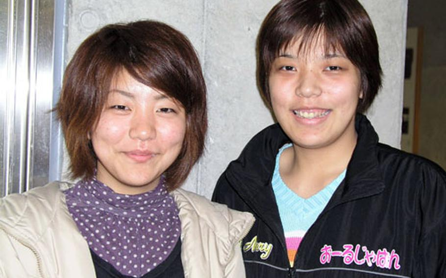 """Natsumi Moriya, left, and her sister Sayaka Nakachi are part of the local musical group Amawari Roman. Their musical, """"Amawar,"""" is helping change the image of a former feudal lord, Amawari, from traitor to hero."""