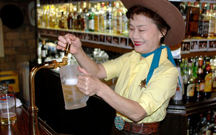 Keiko Tamano has worked at The Westerner for more than 30 years. The Westerner is one of the more popular bars in Sasebo, Japan, among Americans, offering an ample supply of comfort, hospitality and Old West flavor.