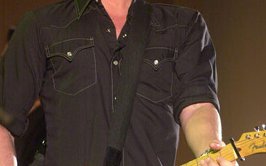 Dierks Bentley, the 2005 Country Music Association Horizon Award winner for emerging artist, was so close to the audience at a recent concert in Baumholder, Germany, that the crowd could reach out and touch him.