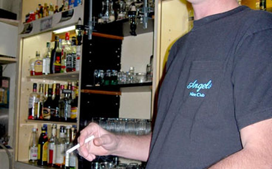 John Lewis, 40, owner of John's Tavern in Fussa, Japan, near Yokota Air Base, opened the bar in July 2001 after a revelation at a friend's bar just up the street.