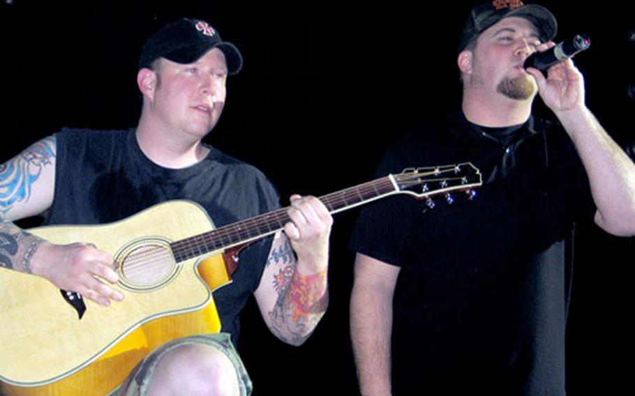 """Fred Melott, left, and Peter Roy perform as Black 13. The two wrote music for the soundtrack of """"Turn Left,"""" a film recently released on DVD."""