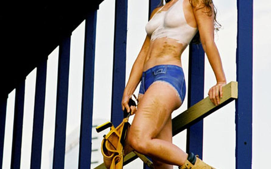 A model painted to look like a construction worker in the 2007 Camouflage calendar.