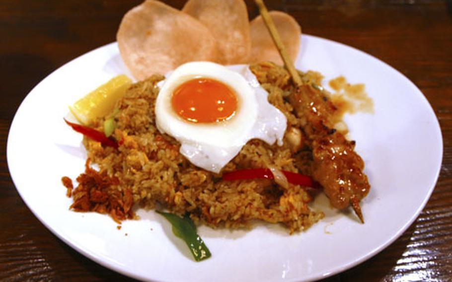 One of Monsoon Café's Asian-themed rice dishes awaits a hungry customer. The establishment is a few minutes walk from Roppongi and the Hardy Barracks Army complex in Tokyo.