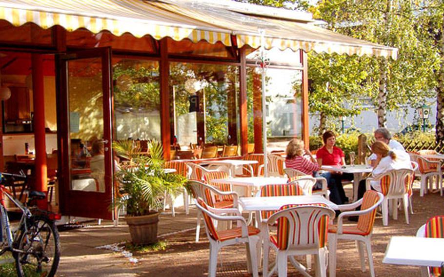 Patrons enjoys a Sunday afternoon at the Radieschen restaurant in Darmstadt-Eberstadt, Germany.