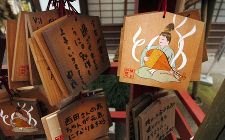 Japanese patrons write wishes on wooden blocks and place them at the Hachimangu shrine for good luck and homage to their gods as part of the Shinto religion.