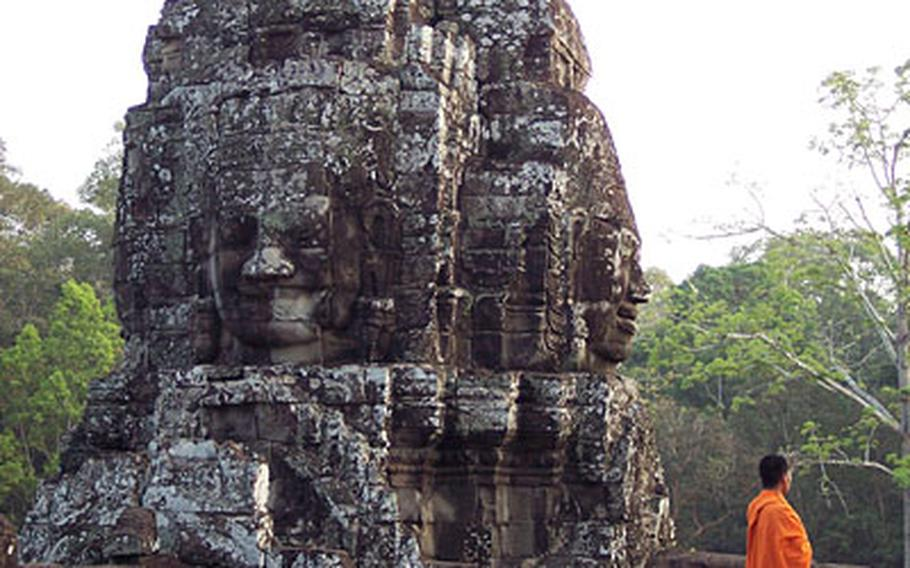 A Buddhist monk looks out from 13th Century Bayon, the last state Hindu temple to be built under the Angkor civilization.