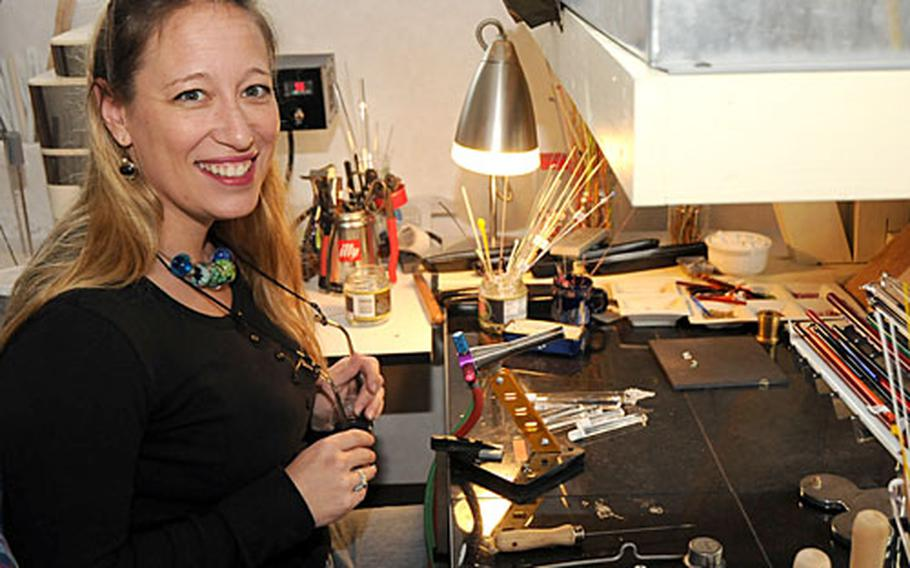 Julia Landecker, a lieutenant commander in the Navy, creates one-of-a-kind lampwork glass beads using techniques she learned in Italy.