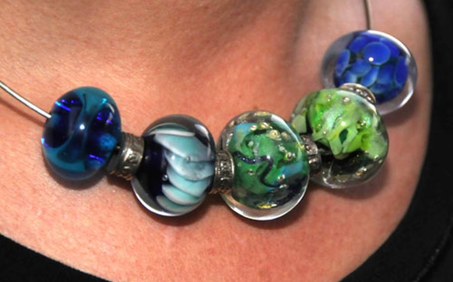 Julia Landecker wears a necklace that she designed using her own beads.