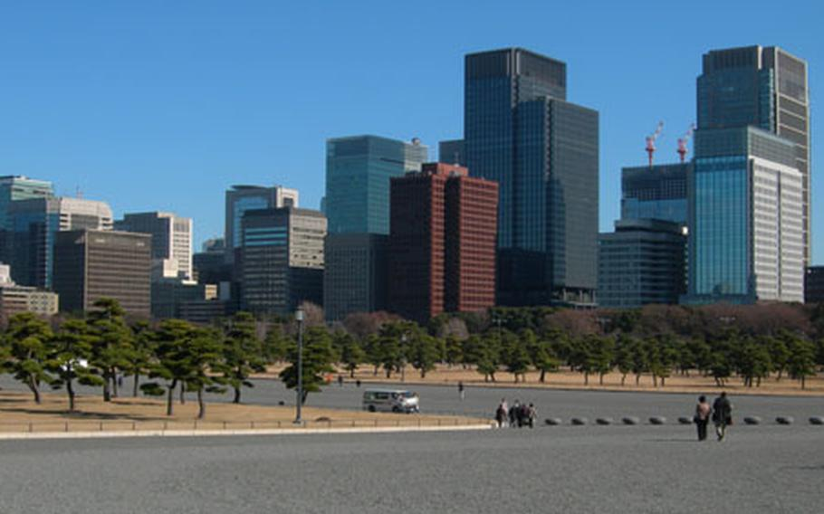 Visitors walk through the large open areas surrounding the Imperial Palace. The grounds around the palace act as a park, much like Central Park in New York City.
