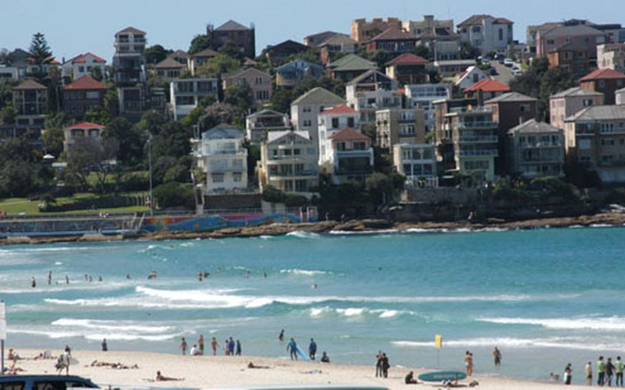 World-famous Bondi Beach is a major attraction in Sydney, Australia. The magnificent setting features white sand, clear surf and abundant sunshine. Shaped like a horseshoe, it's surrounded on both sides by large rocks and Mediterranean-style houses.