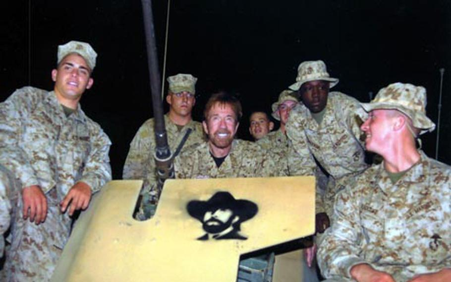 Actor Chuck Norris spends some time with troops during a USO trip to Iraq.