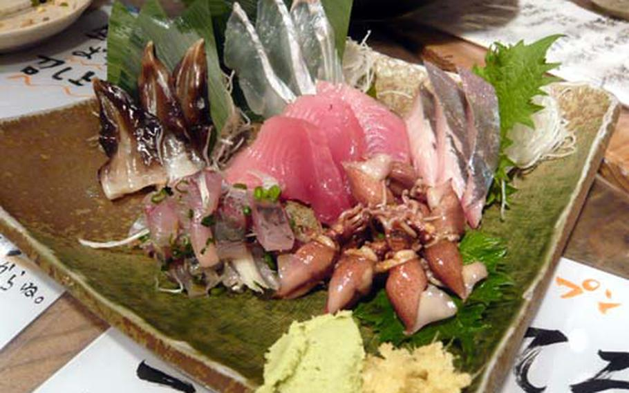 Assorted fresh slices of raw fish, called sashimi, is fresh and in season at Uoshin. The types of fish vary depending on what that day's catch is.