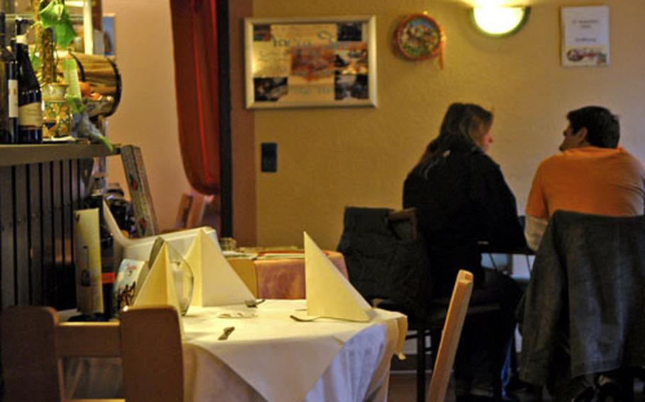 A couple enjoys a quiet dinner at Trattoria da Salvatore Italian restaurant.