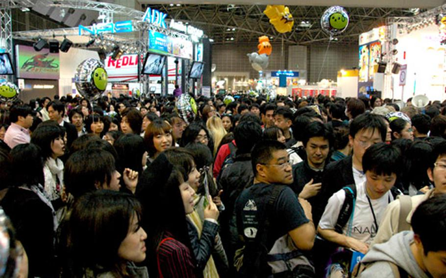 Fans pack the hall of Tokyo Big Site, home of the 2009 Tokyo International Anime Fair.