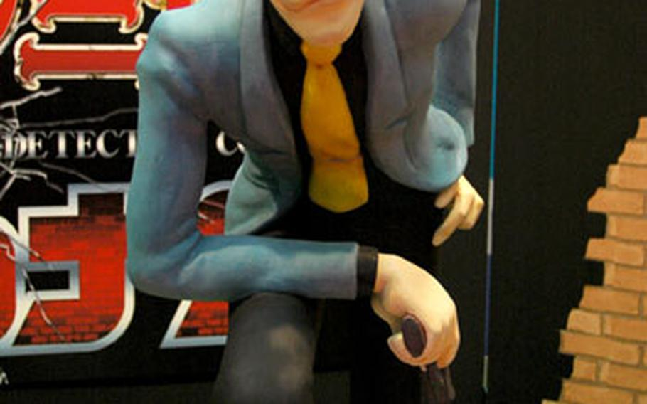 """A statue of famed anime character Lupin III winks at passers by in a booth advertising his upcoming television special """"Lupin III vs. Detective Conan"""" at the 2009 Tokyo International Anime Fair."""