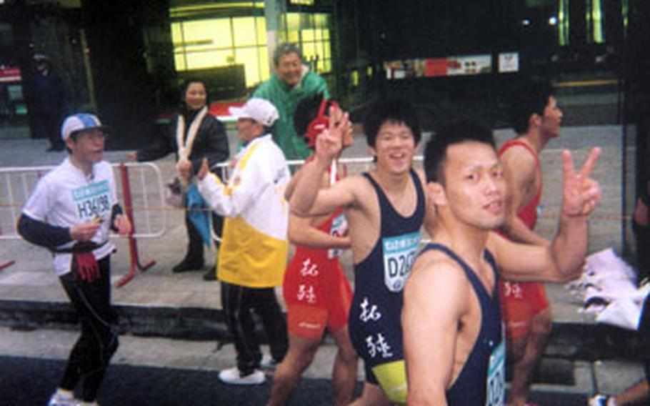 This group of wrestlers ran together throughout the entire marathon, even carrying one of their mates to the finish line after he suffered an injury.