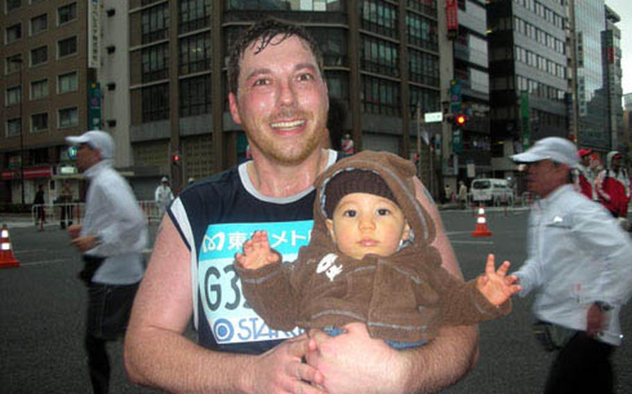In Nihonbashi, runner and writer Paul Newell finally saw his family, something he describes as a huge pick-me-up. He's pictured with his 8-month-old, Alex.