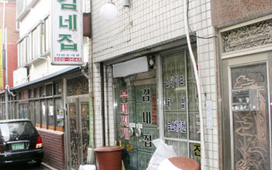 """In the Shinjang Shopping Mall area near Osan Air Base, the Kim Neh Jeep restaurant is popular among locals for its house specialty, """"bu-teh chi-geh,"""" a spicy stew that came about during the hard days of the Korean War."""