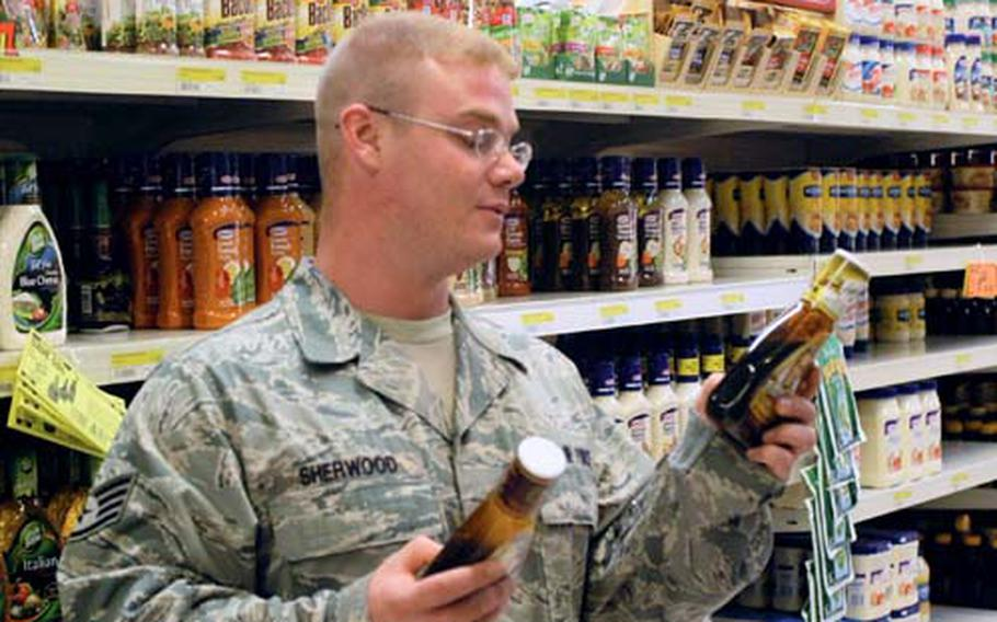Staff Sgt. Phillip Sherwood compares the labels of two salad dressings during a Supermarket Savvy tour of the commissary at Aviano Air Base, Italy, last month. The base plans to offer such tours on a regular basis, joining other military facilities around the world that are trying to educate servicemembers and their families about smart food choices.
