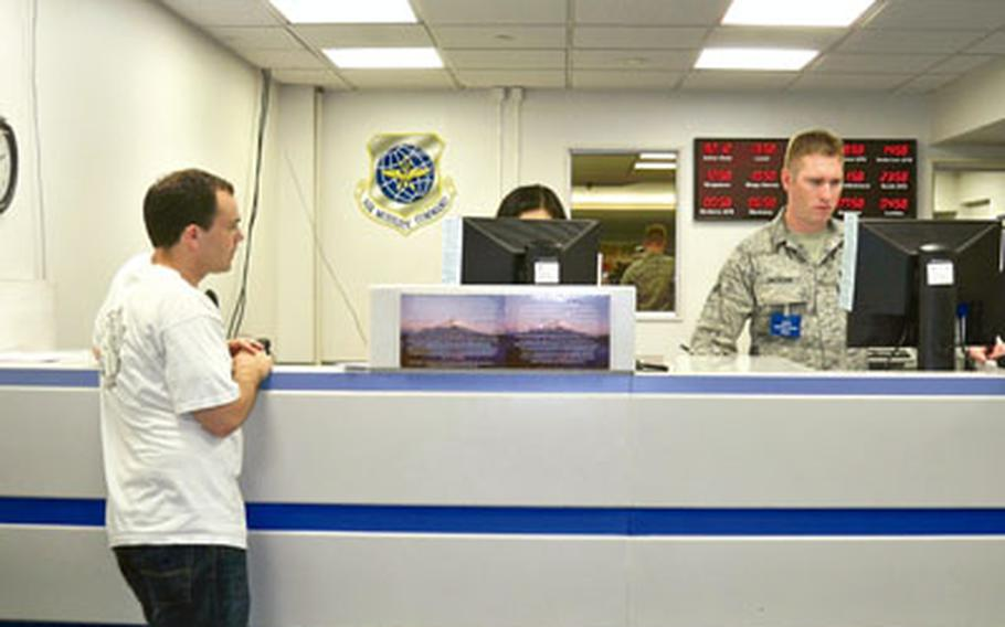 Tim Wightman waits yet again — this time, at the passenger service counter at the Yokota Air Base's Air Mobility Command terminal — ahead of his first Space-A flight July 31.