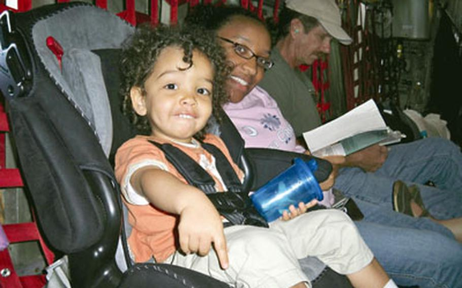 Dallin and Leslie Wightman settle in for their Space-A flight aboard a C-130 bound for Naval Air Facility Atsugi.