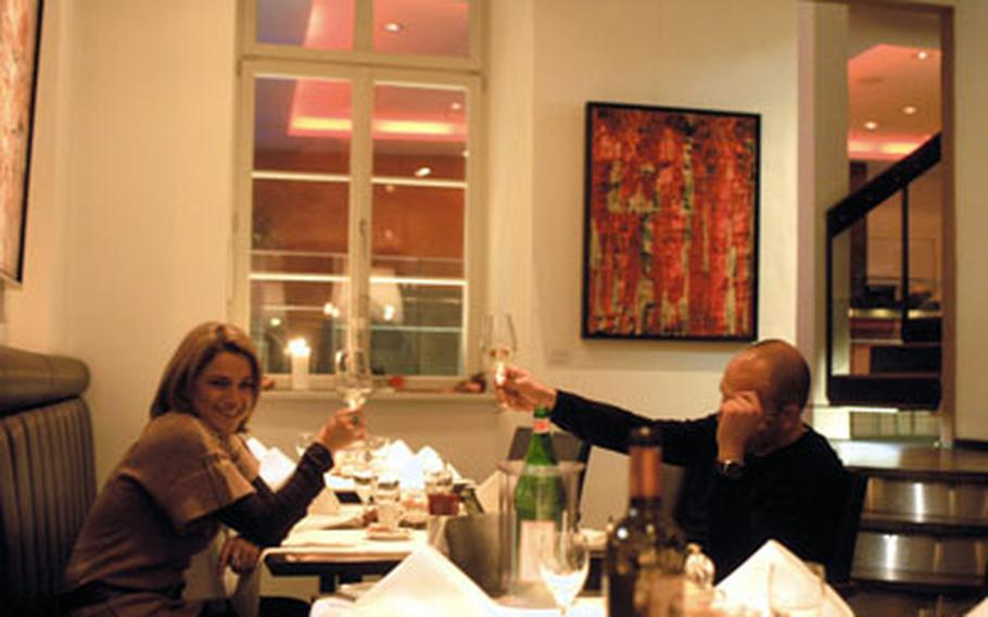 A happy couple toast each other at the Restaurant Romer in Heidelberg, Germany. The restaurant, though a bit pricey, offers a variety of creative dishes and an inviting setting.