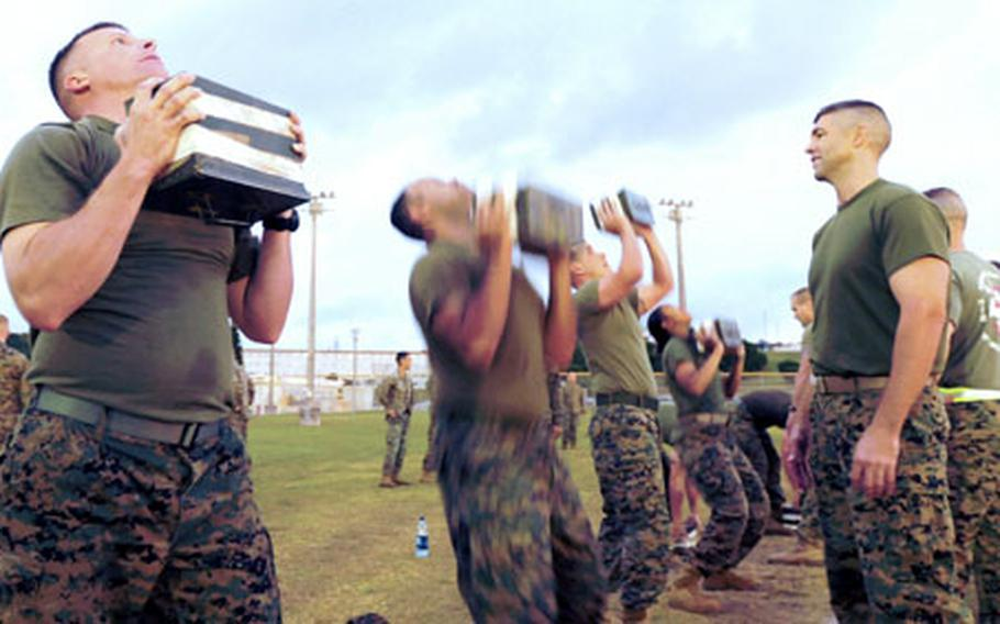 Marines perform the ammunition-can llift during the combat fitness test at Camp Foster, Okinawa.