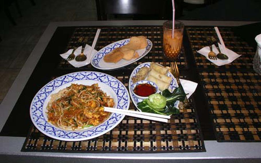 Pad Thai with chicken, left, and spring rolls are two of the stars on the menu at Thailand 2 Restaurant near Osan Air Base, South Korea.