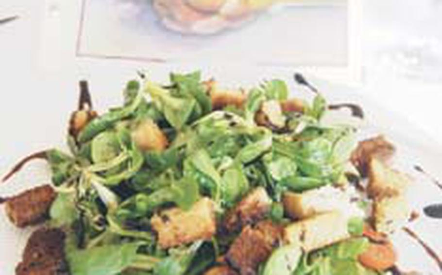 The Feldsalat salad features fresh plum tomatoes, homemade croutons and balsamic dressing.