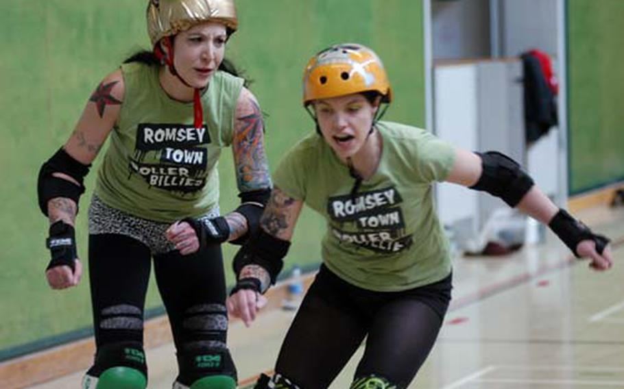 Romsey Town Rollerbillies teammates Katherine Anders, left, and Sarah Sole practice maneuvers during a training session in Cambridge, England.