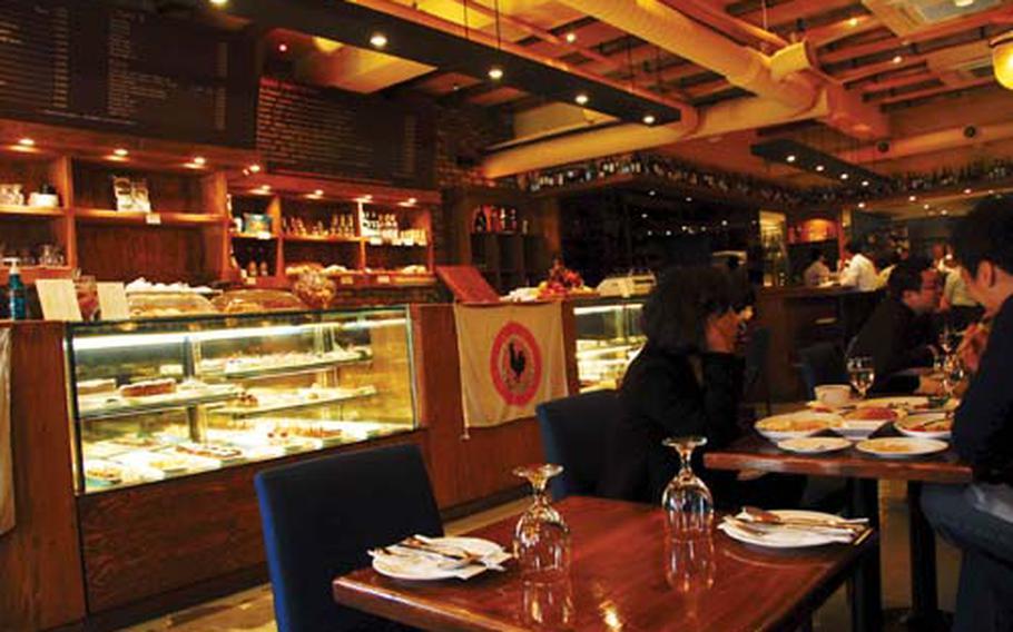 Customers sit inside La Bocca, an Italian restaurant in Itaewon, South Korea.