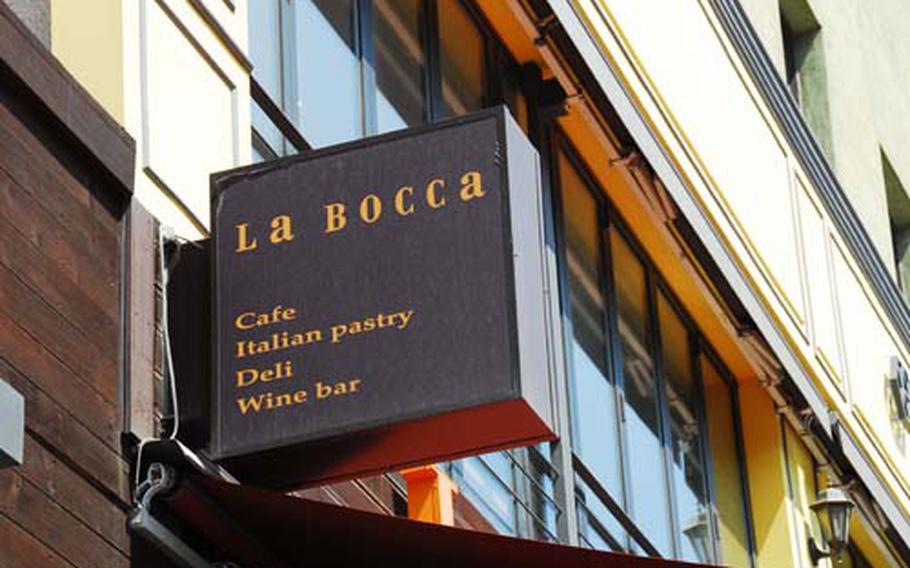 La Bocca sign seen is a standout in its neighborhood of often overpriced restaurants.