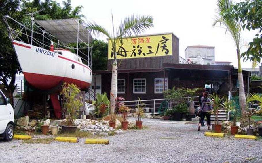 A sailboat that seats eight to 10 people is the first thing to greet visitors at the Umizoku Kobou, or Ocean Family Studio, in Okinawa City.