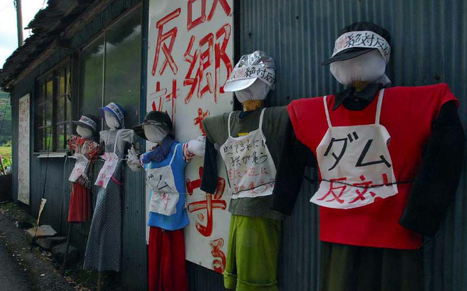 Dummies stand in protest of the Japanese government's plan to flood part of the Ishiki Valley to bolster the public water supply.